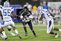 11 October 2008:  FIU wide receiver Junior Mertile (2) attempts to evade Middle Tennessee State cornerback Jeremy Kellem (20) and linebacker Andrew Harrington (55) in the FIU 31-21 victory over Middle Tennessee at FIU Stadium in Miami, Florida.