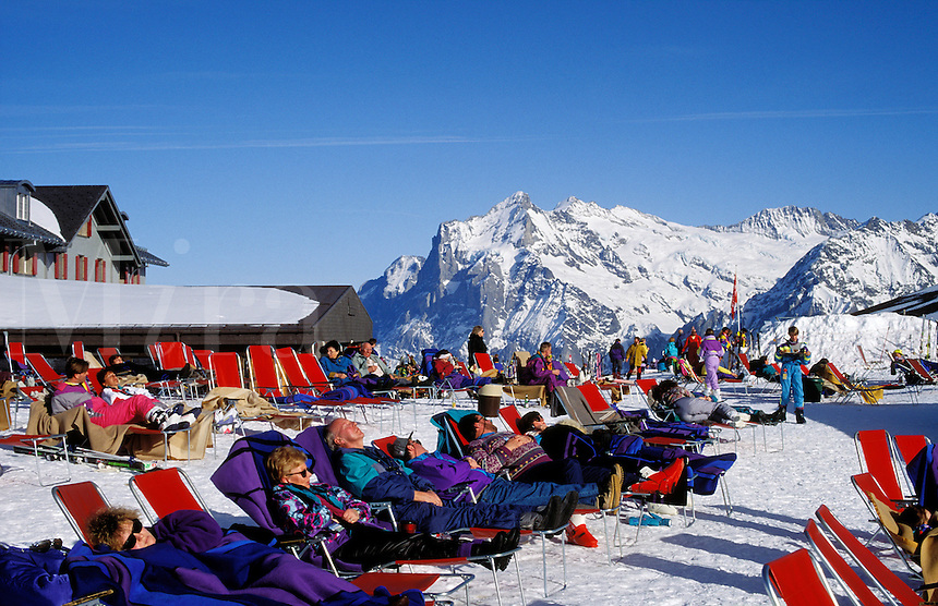 Switzerland. Grindelwald.  Sun terrace at the Männlichen Ski Station in winter. The Wetterhorn in the background..