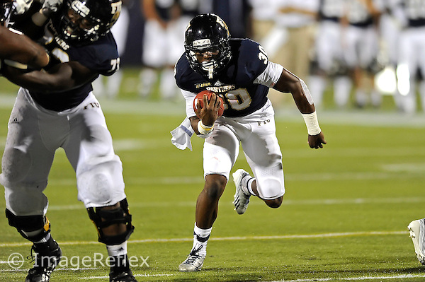 14 September 2013:  FIU running back Silas Spearman III (30) carries the ball in the second half as the Bethune-Cookman Wildcats defeated the FIU Golden Panthers, 34-13, at FIU Stadium in Miami, Florida.
