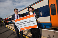Lawrence Bowman of East Midlands Trains and Lincoln Town Crier Karen Crow at the launch of the new Lincoln to Nottingham train timetable