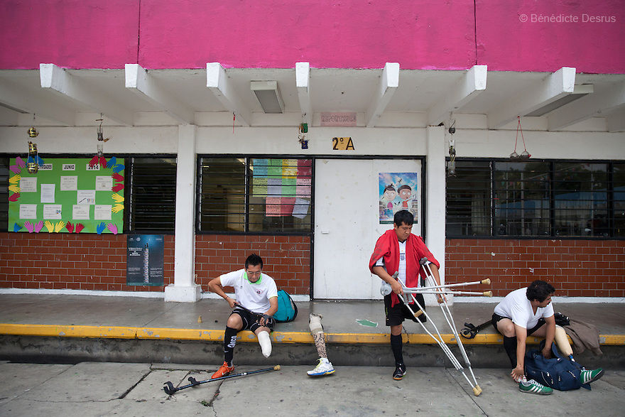 "Players from Guerreros Aztecas remove their prosthetic legs and get changed before training in Mexico City, Mexico on June 26, 2014. Guerreros Aztecas (""Aztec Warriors"") is Mexico City's first amputee football team. Founded in July 2013 by five volunteers, they now have 23 players, seven of them have made the national team's shortlist to represent Mexico at this year's Amputee Soccer World Cup in Sinaloa this December. The team trains twice a week for weekend games with other teams. No prostheses are used, so field players missing a lower extremity can only play using crutches. Those missing an upper extremity play as goalkeepers. The teams play six per side with unlimited substitutions. Each half lasts 25 minutes. The causes of the amputations range from accidents to medical interventions – none of which have stopped the Guerreros Aztecas from continuing to play. The players' age, backgrounds and professions cover the full sweep of Mexican society, and they are united by the will to keep their heads held high in a country where discrimination against the disabled remains widespread. (Photo by Bénédicte Desrus)"