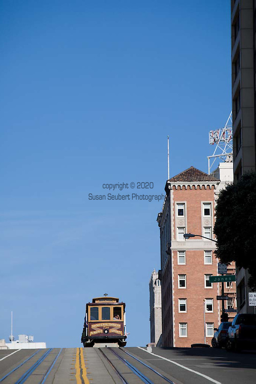 The Cable Car in San Francisco is run and owned by the city.  It is the only moving national landmark in the world.  The Powell/Hyde line is considered the most scenic.