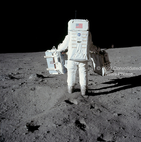 "The Moon - (FILE) -- Astronaut Edwin E. ""Buzz"" Aldrin carries experiments for deployment on the Moon on Sunday, July 20, 1969..Credit: NASA via CNP"