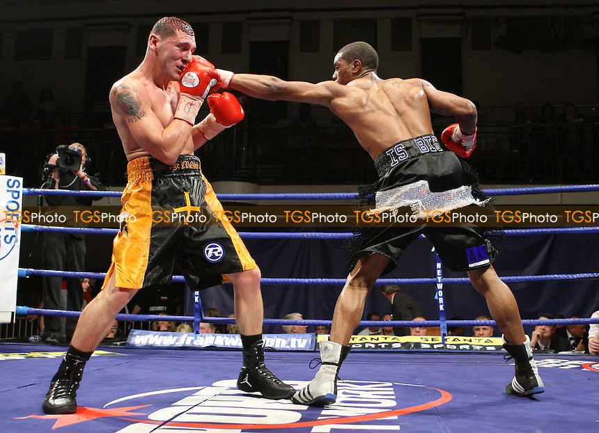 Anthony Small (Deptford, black/white shorts) defeats George Katsimpas (Weston-super-Mare, black/yellow shorts) in a Light-Middleweight contest for the British Southern Area Title at York Hall, Bethnal Green, promoted by Frank Warren/Sports Network - 14/06/08 - MANDATORY CREDIT: Gavin Ellis/TGSPHOTO. Self-Billing applies where appropriate. NO UNPAID USE. Tel: 0845 094 6026