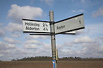 Rural road sign with distances, Suffolk, England