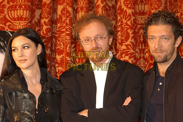 "MONICA BELLUCCI, FREDERIC SCHOENDERFFER & VINCENT CASSEL.Photocall for a Frederic Schoendoerffer film ""Agents Secrets""  aka ""Secret Agents"" at Hotel St Regis, Rome, Italy, October 29th 2004.                            .portrait headshot married husband wife.Ref: LC.www.capitalpictures.com.sales@capitalpictures.com.©Luca Cavallari/Capital Pictures ."