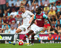 Stephen Kingsley of Swansea and Victor Moses of West Ham United   during the Barclays Premier League match between West Ham United and Swansea City  played at Boleyn Ground , London on 7th May 2016
