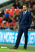 5th October 2017, Wembley Stadium, London, England; FIFA World Cup Qualification, England versus Slovenia; England Manager Gareth Southgate looks on as a paper airplane thrown from the crowd lands near him