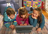 Kids using the laptop computer
