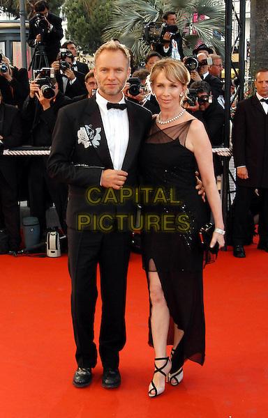 STING & TRUDI STYLER.Cannes Film Festival 2003.long black split dress, strappy sandals.www.capitalpictures.com.sales@capitalpictures.com.©Capital Pictures
