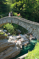 Lavertezzo, Ticino, Switzerland, August 2009. The Valle Verzasca valley offers a spectacular rocky gorge with turquoise waters and a roman bridge. Ticino is the subtropical canton of switzerland where Italian is the first language. Photo by Frits Meyst/Adventure4ever.com