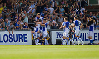 Stuart Sinclair of Bristol Rovers is mobbed after scoring his side's first goal during the Sky Bet League 1 match between Bristol Rovers and Fleetwood Town at the Memorial Stadium, Bristol, England on 26 August 2017. Photo by Mark  Hawkins.