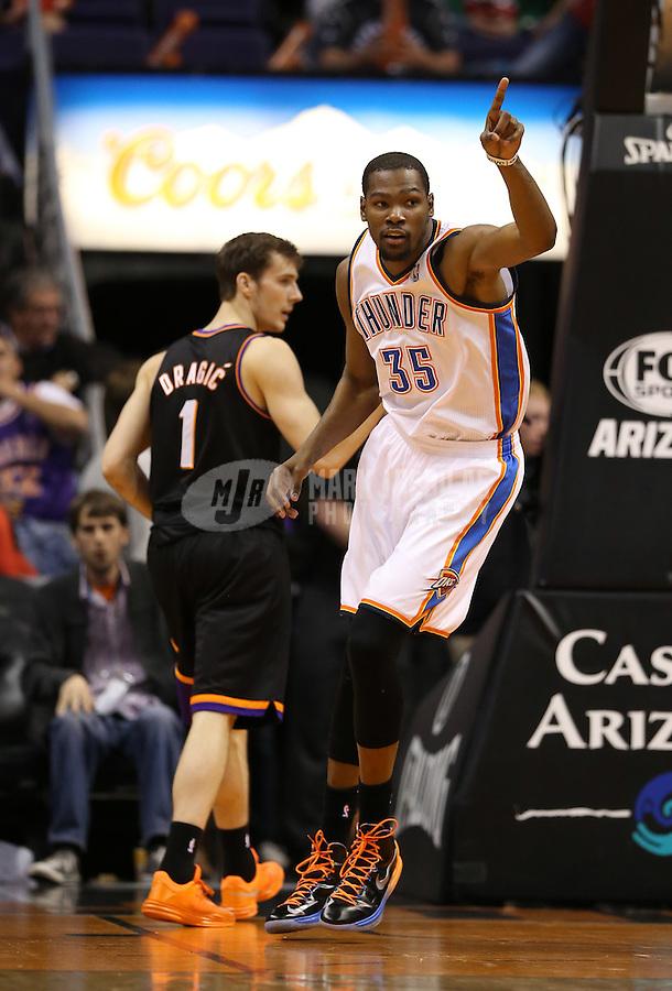 Feb. 10, 2013; Phoenix, AZ, USA: Oklahoma City Thunder forward Kevin Durant (35) celebrates a score in the third quarter against the Phoenix Suns at the US Airways Center. Mandatory Credit: Mark J. Rebilas-