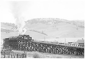 D&amp;RGW #483 pushing two loaded coal cars up the Sargent coaling trestle, looking westerly.<br /> D&amp;RGW  Sargent, CO  Taken by Kindig, Richard H. - 9/20/1952