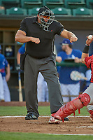 Umpire Lance Beckert handles the calls behind the plate during the game between the Ogden Raptors and the Orem Owlz at Lindquist Field on July 27, 2019 in Ogden, Utah. The Raptors defeated the Owlz 14-1. (Stephen Smith/Four Seam Images)