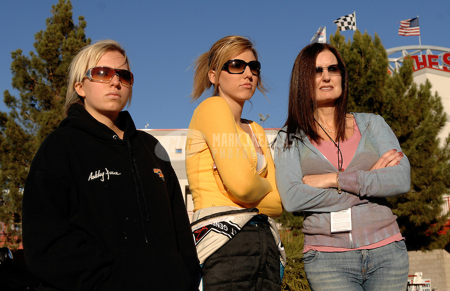 "Jan 20, 2007; Las Vegas, NV, USA; NHRA Super Comp drivers Brittany Force , Courtney Force with their mother Lauri Force during preseason testing at ""The Strip"" at Las Vegas Motor Speedway in Las Vegas, NV. Mandatory Credit: Mark J. Rebilas"