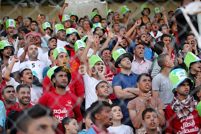 Fans attend the final match of the Gaza Cup between Shabab Jabalia and Shabab Khan Younis, at Yarmuk stadium in Gaza City, on April 24, 2016. Photo by Ashraf Amra