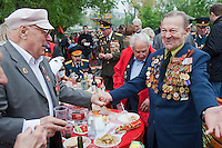 Moscow, Russia, 09/05/2012..Military veterans greet one another as Russian World War Two veterans and well-wishers gather in Gorky Park during the countrys annual Victory Day celebrations.