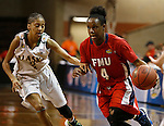 SIOUX FALLS MARCH 22:  Camille Dash #4 of Francis Marion drives past Adriana Dent #2 of Alaska Anchorage during their quarterfinal game at the NCAA Women's Division II Elite 8 Tournament at the Sanford Pentagon in Sioux Falls, S.D.  (Photo by Dick Carlson/Inertia)