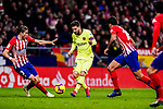 Lionel Messi of FC Barcelona (C) dribbles Filipe Luis of Atletico de Madrid (L) during the La Liga 2018-19 match between Atletico Madrid and FC Barcelona at Wanda Metropolitano on November 24 2018 in Madrid, Spain. Photo by Diego Souto / Power Sport Images