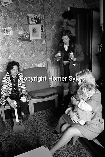 Chiswick Women Aid Shelter for Battered Women. London England 1975. Mothers and their children in a morning room.