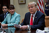 U.S. President Donald Trump speaks as he meets with small business leaders including Irma Aguirre, with the Mexican Bistro Cafe, left, in the Roosevelt Room of the White House in Washington, D.C., U.S., on Monday, Jan. 30, 2017. Trump defended the immigration clampdown that sparked a global backlash over the weekend by blaming the confusion at airports on protesters and on a computer outage at Delta Air Lines Inc. that caused flight cancellations. <br /> Credit: Andrew Harrer / Pool via CNP