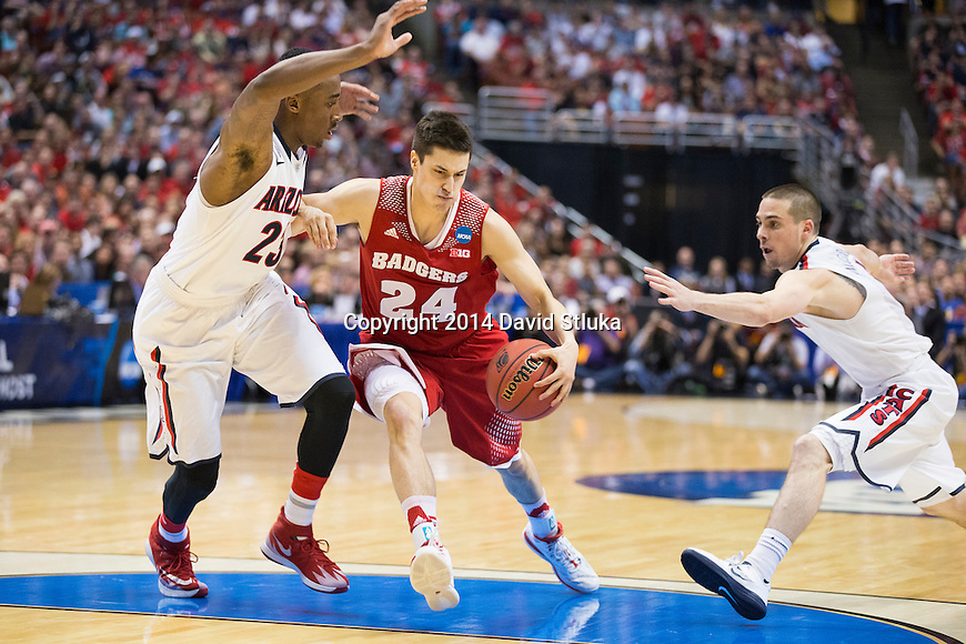 Wisconsin Badgers guard Bronson Koenig (24) handles the ball during  a regional final NCAA college basketball tournament game against the Arizona Wildcats Saturday, March 29, 2014 in Anaheim, California. The Badgers won 64-63 (OT). (Photo by David Stluka)