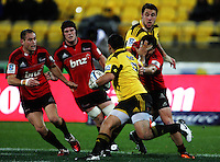 Piri Weepu fends off Zac Guildford. Super 15 rugby match - Crusaders v Hurricanes at Westpac Stadium, Wellington, New Zealand on Saturday, 18 June 2011. Photo: Dave Lintott / lintottphoto.co.nz