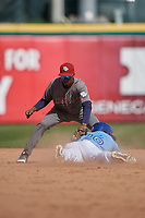 Lehigh Valley IronPigs shortstop Malquin Canelo (8) attempts to tag Anthony Alford (26) sliding in safely on a stolen base during an International League game against the Buffalo Bisons on June 9, 2019 at Sahlen Field in Buffalo, New York.  Lehigh Valley defeated Buffalo 7-6 in 11 innings.  (Mike Janes/Four Seam Images)
