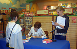 "A fan with Carolyn Hennesy ""Diane Miller"" - GH at Barnes and Noble on May 19, 2009 with her new book Pandora Gets Lazy - the third book in a series of 7. They are based on the Seven Deadly Sins. (Photo by Sue Coflin/Max Photos)"