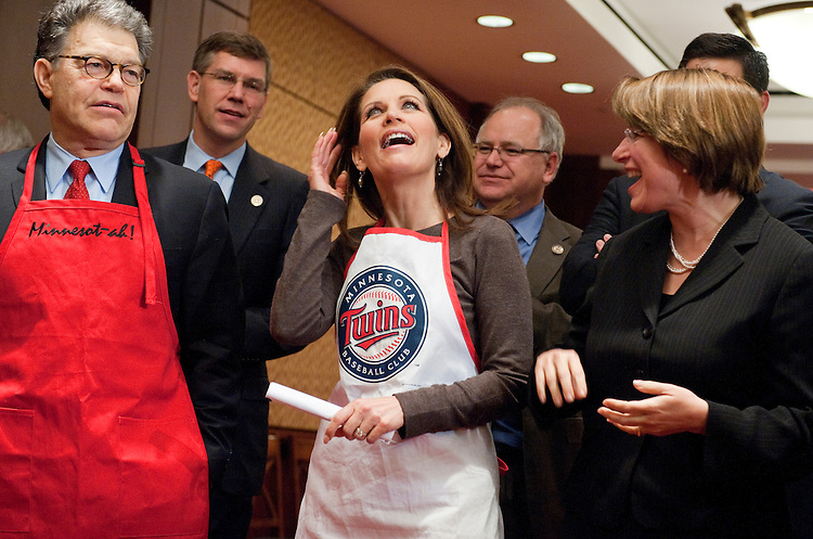 "UNITED STATES - MARCH 07:  From left, Sen. Al Franken, D-Minn., Reps. Erik Paulsen, R-Minn., Michele Bachmann, R-Minn., Tim Walz, D-Minn., and Sen. Amy Klobuchar, D-Minn., prepare for the second annual ""hotdish"" competition in the Capitol Visitor Center, featuring casserole-like dishes from members of the Minnesota Congressional Delegation.  The dishes of Sen. Franken and Rep. Chip Cravaack, R-Minn., tied for first place in the competition.  (Photo By Tom Williams/CQ Roll Call)"