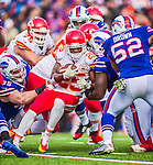 9 November 2014: Kansas City Chiefs running back Jamaal Charles is tackled after taking a screen pass for a 12-yard gain in the third quarter against the Buffalo Bills at Ralph Wilson Stadium in Orchard Park, NY. The Chiefs rallied with two fourth quarter touchdowns to defeat the Bills 17-13. Mandatory Credit: Ed Wolfstein Photo *** RAW (NEF) Image File Available ***