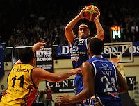 Brendon Polybank passes to Ernest Scott under pressure from Pistons captain Pero Cameron during game two of the NBL Final basketball match between the Wellington Saints and Waikato Pistons at TSB Bank Arena, Wellington, New Zealand on Friday 20 June 2008. Photo: Dave Lintott / lintottphoto.co.nz