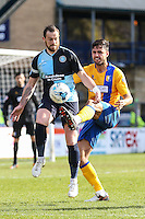Paul Hayes of Wycombe Wanderers and Lee Collins of Mansfield Town during the Sky Bet League 2 match between Wycombe Wanderers and Mansfield Town at Adams Park, High Wycombe, England on 25 March 2016. Photo by David Horn.