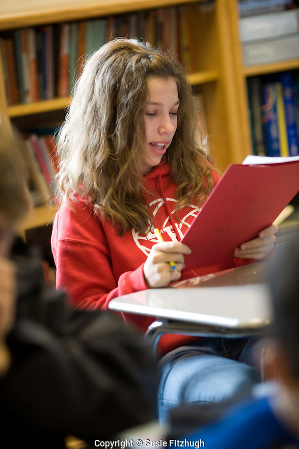 Student reads her work to the class.