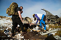09/11/19<br /> <br /> Hikers place memorial crosses.<br /> <br /> Surrounded by fresh overnight snow, hikers gather, in one of the remotest areas of the Derbyshire Peak District, for a two minute silence and to lay wreaths and crosses on the wreckage of an American RB29 bomber, known  as 'Over-Exposed' which crashed on Bleaklow Moor near Higher Shelf Stones, killing all thirteen crew in November 1948. Piles of twisted metal have been piled up to form a makeshift memorial that lies next to whole engines, pieces of fuselage, wings, wheels and other twisted parts of aluminium that have lain on the moors for  71 years.<br /> <br /> Today prayers were said, a harmonica player performed the Last Post and Taps (the US equivalent) and members of the Woodhead Mountain Rescue teams remembered their forbears who were first to arrive at the crash scene after the bomber descended in low cloud hitting the high peak.<br /> <br /> All Rights Reserved: F Stop Press Ltd.  <br /> +44 (0)7765 242650 www.fstoppress.com