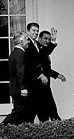 Washington, DC., USA, February 14, 1984<br /> President Ronald Reagan walks  with President Hosni Mubarak of Egypt and King Hussein II of Jordon along the colonnade of the Rose Garden. Credit: Mark Reinstein/MediaPunch