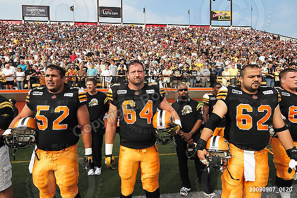 September 7, 2009; Hamilton, ON, CAN; Hamilton Tiger-Cats offensive lineman George Hudson (52) offensive lineman Dan Goodspeed (64) offensive lineman Marwan Hage (62). CFL football - the Labour Day Classic - Toronto Argonauts vs. Hamilton Tiger-Cats at Ivor Wynne Stadium. The Tiger-Cats defeated the Argos 34-15. Mandatory Credit: Ron Scheffler.