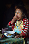 Three-year old Nyda Diaz Vasquez eats breakfast in her home in Tuixcajchis, a small Mam-speaking Maya village in Comitancillo, Guatemala.