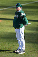 Charlotte 49ers head coach Loren Hibbs (49) coaches first base during the game against the Louisiana Tech Bulldogs at Hayes Stadium on March 28, 2015 in Charlotte, North Carolina.  The 49ers defeated the Bulldogs 9-5 in game two of a double header.  (Brian Westerholt/Four Seam Images)