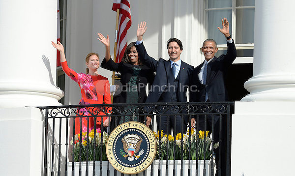 United States President Barack Obama, right, First Lady Michelle Obama, left center, and Prime Minister Justin Trudeau of Canada, right center, and and Mrs. Sophie Gr&Egrave;goire Trudeau, left, wave from the South Portico of the White House following an Arrival Ceremony in Washington, DC on Thursday, March 10, 2016. <br /> Credit: Olivier Douliery / Pool via CNP/MediaPunch