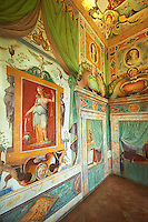 "Room of Glory (Stanza della Gloria ). The Renaissance paintings by Federico Zuccari can be dated to 1566-68. The frescoes in the vaulted ceiling depict the virtues which consent the fulfilment of ""Glory"" with allegorical panels depicting Magnanimity, Fortune, Time and Religion. Trompe-l'?il alcoves reveal the Cardinals hat of Ippolito d'Este  . Villa d'Este, Tivoli, Italy. A UNESCO World Heritage Site."