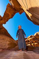 Bedouin boy, Burdah Rock Bridge, Arabian Desert, Wadi Rum, Jordan.