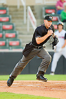 Home plate umpire Charlie Tierney hustles into position during the South Atlantic League game between the Augusta GreenJackets and the Kannapolis Intimidators at CMC-Northeast Stadium on May 2, 2012 in Kannapolis, North Carolina.  The GreenJackets defeated the Intimidators 9-6.  (Brian Westerholt/Four Seam Images)
