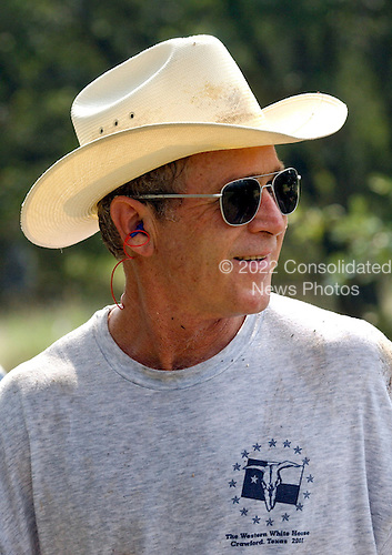 United States President George W. Bush takes a break during work at his ranch in Crawford, Texas, Friday, August 9, 2002. <br /> Mandatory Credit: Eric Draper - White House via CNP
