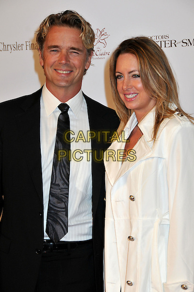 JOHN SCHNEIDER & ELLY (WIFE).11th Annual Lili Claire Benefit Dinner and Concert Gala at the Santa Monica Civic Auditorium, Santa Monica, California, USA..October 4th, 2008.half length black suit jacket white cream coat married husband.CAP/ADM/BP.©Byron Purvis/AdMedia/Capital Pictures.