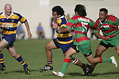 Fehoko tries to run around Waiuku fullback T. Kiel. Counties Manukau Premier Club Rugby, Waiuku vs Patumahoe played at Rugby Park, Waiuku on the 8th of April 2006. Waiuku won 18 - 15
