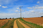 Rural electricity supply lines running across countryside, Alderton, Suffolk, England