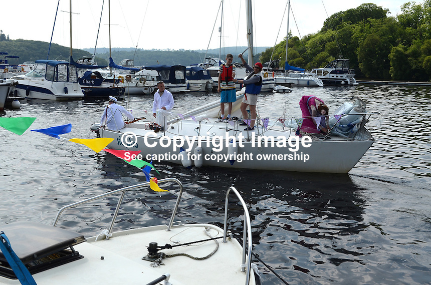 Georgian Day, Lough Erne Yacht Club, Killadeas, Co Fermanagh, N Ireland, UK, 20th July 2013, Jigola, the winner, comes in to moor.  201307202731.   <br /> <br /> Copyright Image from Victor Patterson, 54 Dorchester Park, Belfast, UK, BT9 6RJ<br /> <br /> Tel: +44 28 9066 1296<br /> Mob: +44 7802 353836<br /> Voicemail +44 20 8816 7153<br /> Skype: victorpattersonbelfast<br /> Email: victorpatterson@me.com<br /> Email: victorpatterson@ireland.com (back-up)<br /> <br /> IMPORTANT: If you wish to use this image or any other of my images please go to www.victorpatterson.com and click on the Terms &amp; Conditions. Then contact me by email or phone with the reference number(s) of the image(s) concerned.