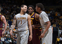 Justin Cobbs of California talks with Tyrone Wallace of California during the game against Arizona State at Haas Pavilion in Berkeley, California on January 29th, 2014.   Arizona State defeated California, 89-78.